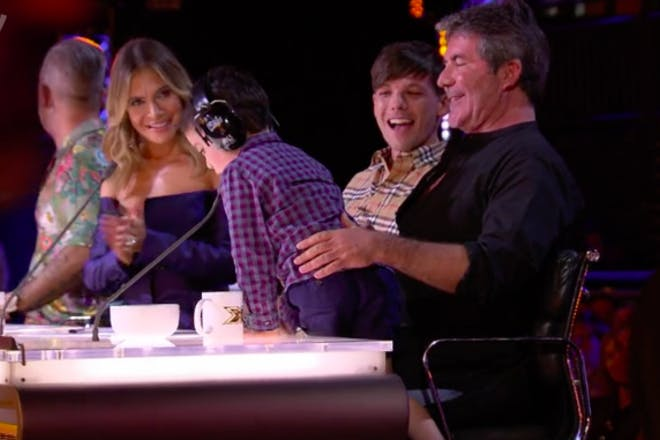 Eric jumps on Simon's lap on The X Factor