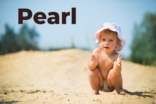 baby on the beach with Pearl written in text