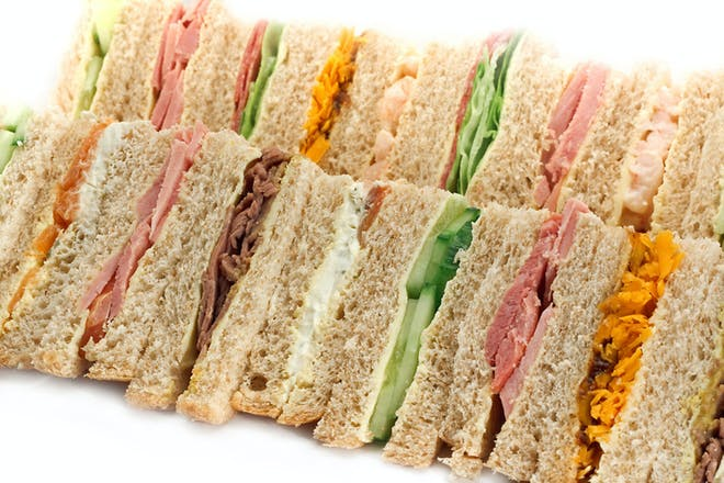 A platter of sandwiches with different fillings