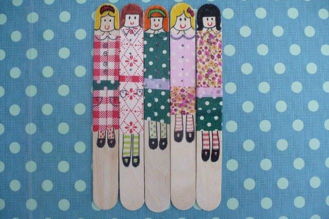 washi dolls on patterned background
