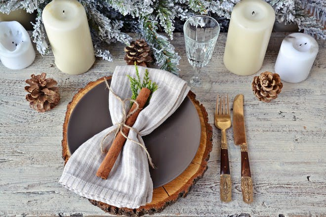 festive Christmas table setting with cinammon stick