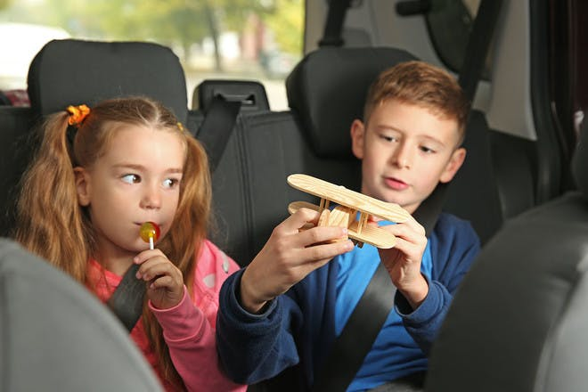 Kids playing in the backseat of the car