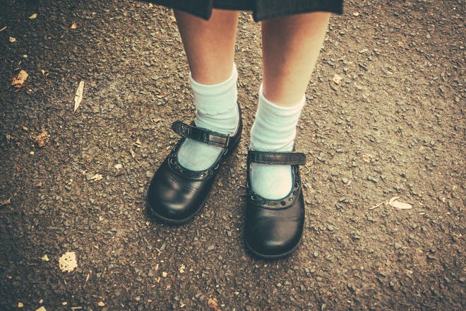 Girl in school shoes and uniform
