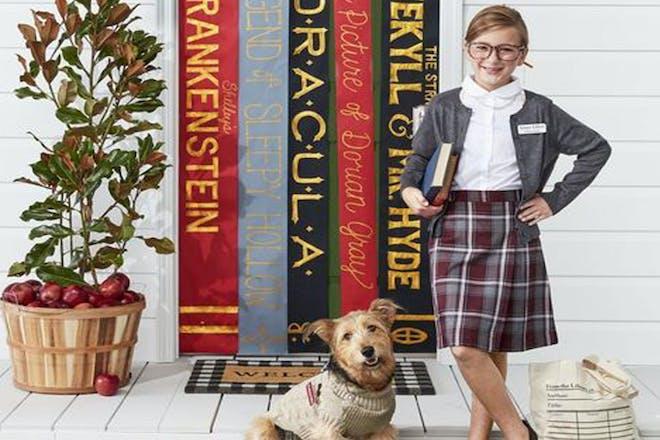 Child dressed as a school teacher