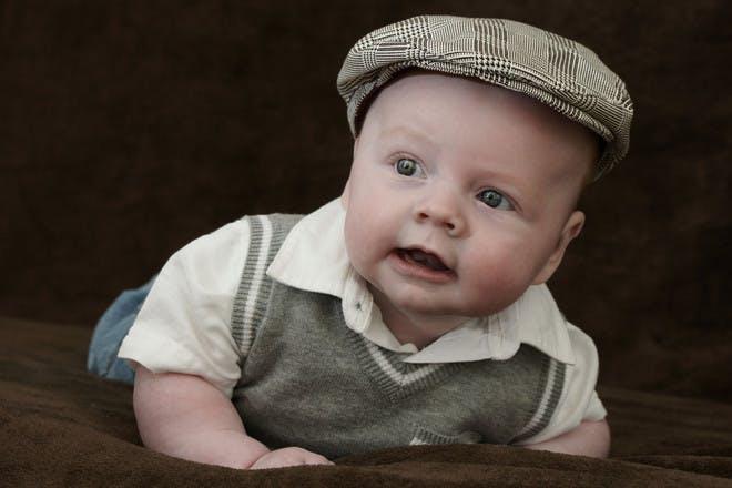 baby in flat cap
