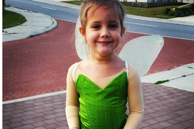 girl dressed as tinkerbell