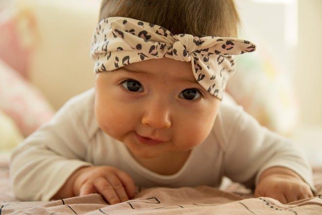 Baby girl with animal print headband