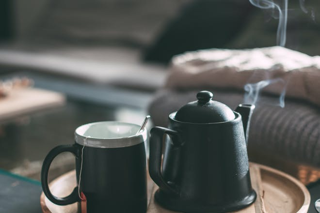 Steaming pot of tea