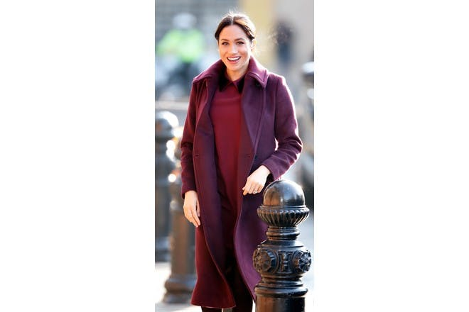 meghan markle pregnant in burgundy coat