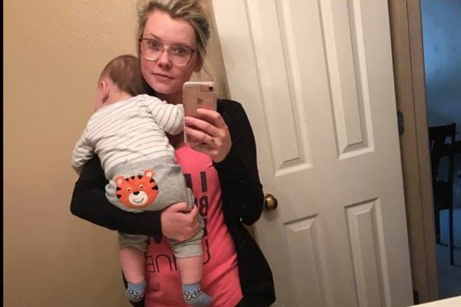 Mum holding baby selfie
