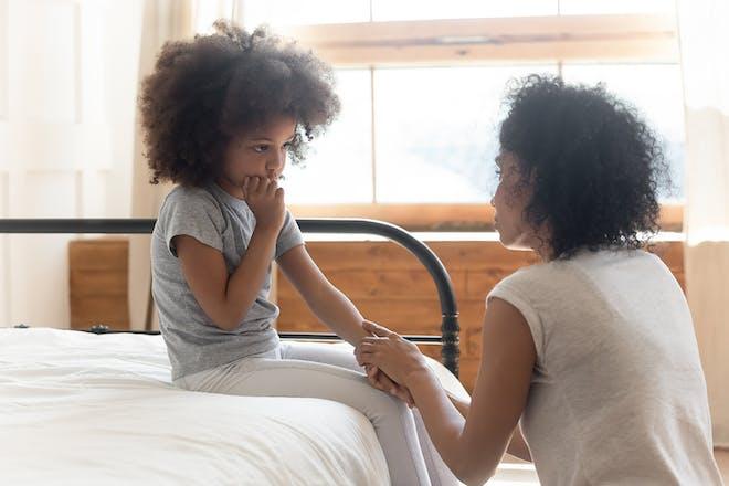Girl and mum talking