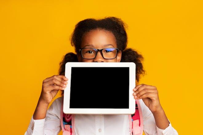 girl holding tablet