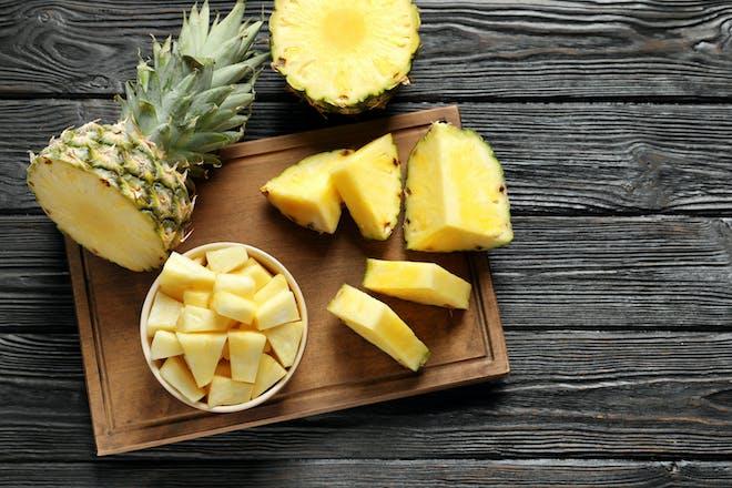 Chopped pineapple on a cutting board