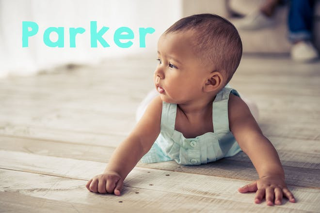 Mixed race baby crawling. Text says Parker