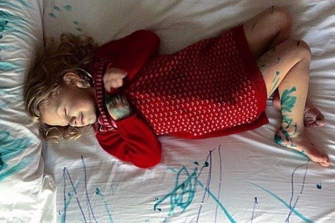 girl lying on ruined bed