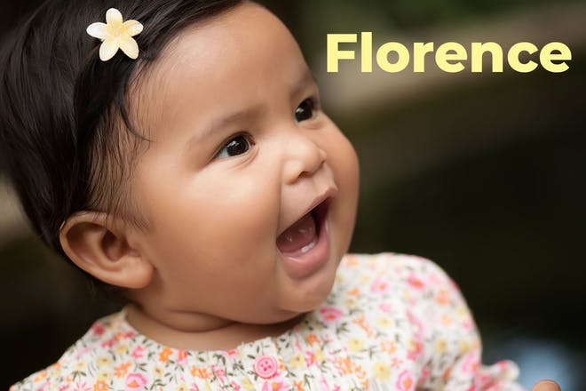 Baby with flower in hair. Name florence written in text.