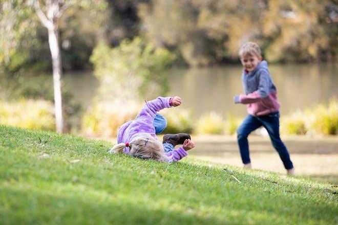 Kids rolling down a hill