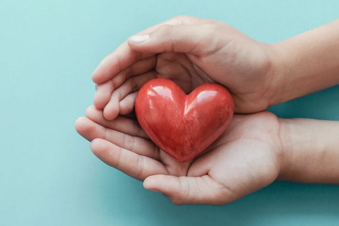 Hands holding little heart