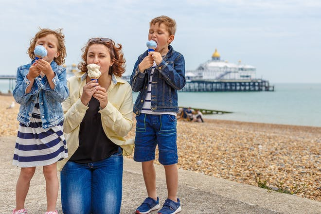 Family eating ice cream at Eastbourne beach