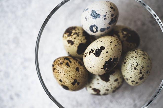 quail eggs in a glass bowl