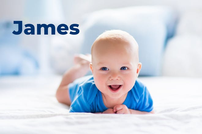 Baby in blue babygro. Name James written in text