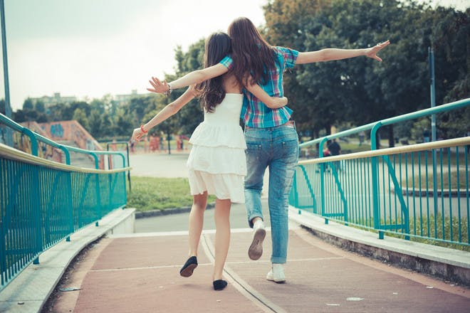 female friends skipping together
