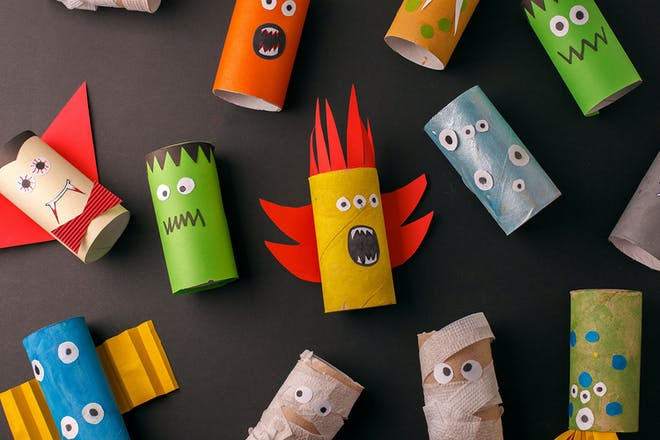 toilet rolls designed to look like monsters with eyes cut out from card and faces drawn on