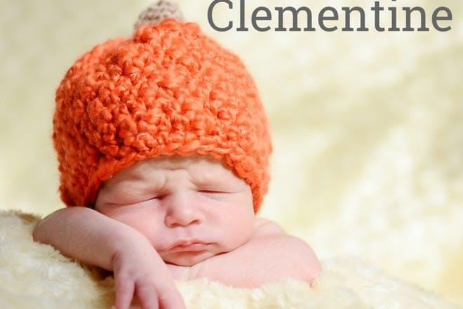 baby with orange hat