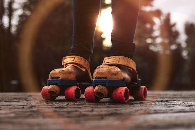 child's feet wearing 1980s roller skates