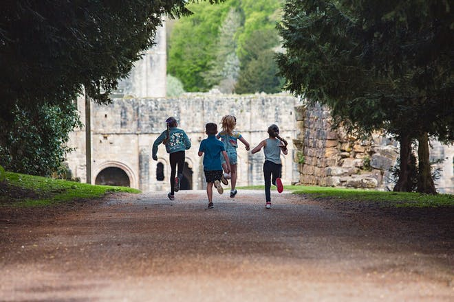 Kids running at Fountains Abbey