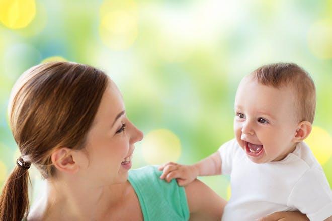 happy mum and baby