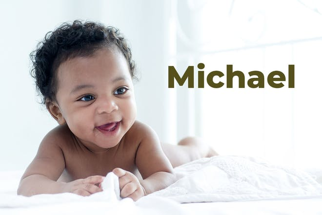 Baby boy pushing himself up on tummy and laughing. Name Michael written in text