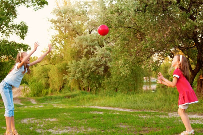 two girls playing catch
