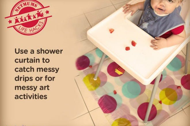 baby in high chair with polka dot shower curtain