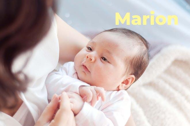 Mum cradling baby. Name Marion written in text