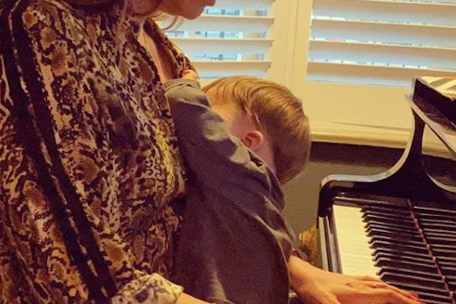 Mylene Klass playing piano while breastfeeding