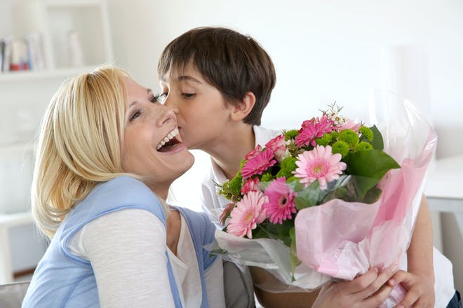 Mother and son holding bouquet