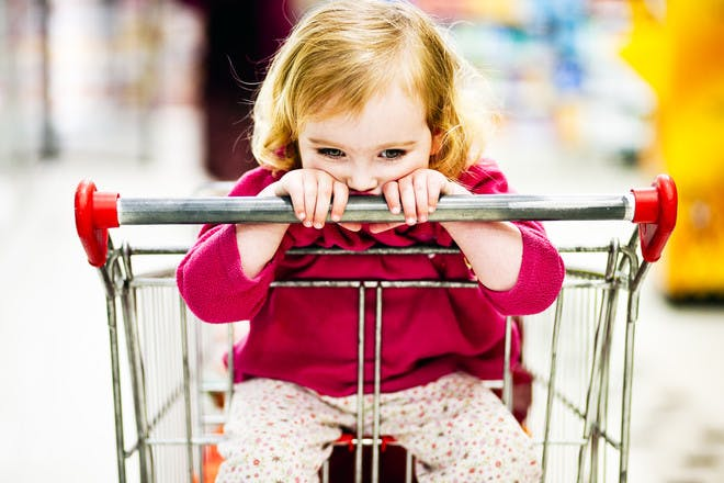 Child in supermarket shopping trolley