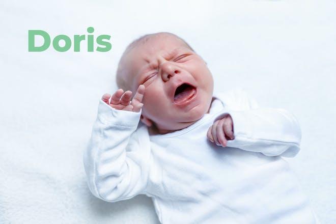 Crying newborn baby. Name Doris written in text