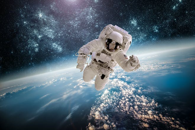 astronaut flying through space