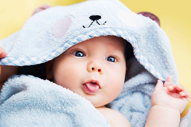 Baby wearing blue hooded towel