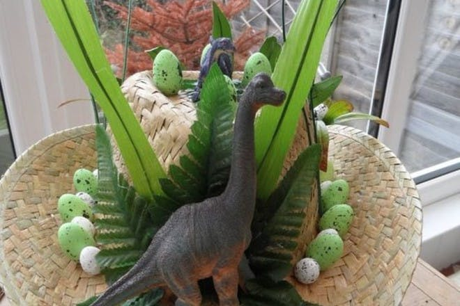 Easter bonnet with toy dinosaur stuck to the top