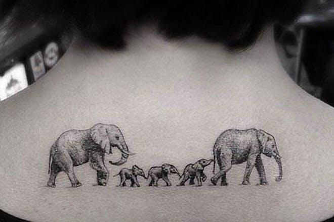 Family of elephants tattoo