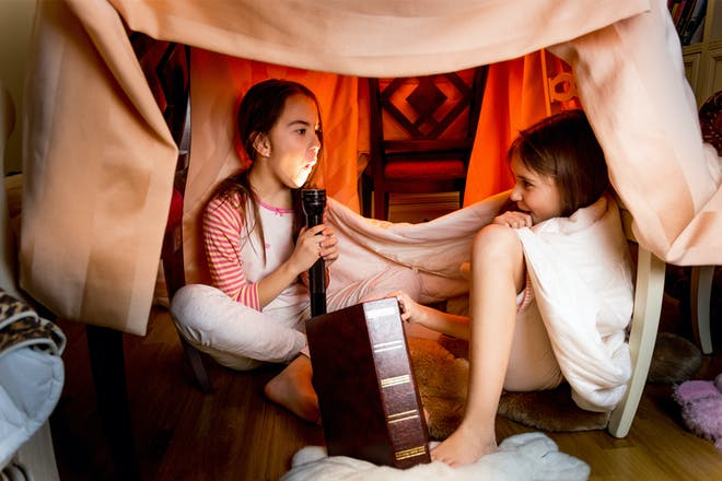 Two sisters telling scary stories