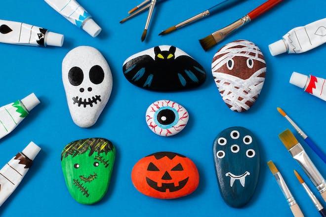 Halloween monsters painted on stones
