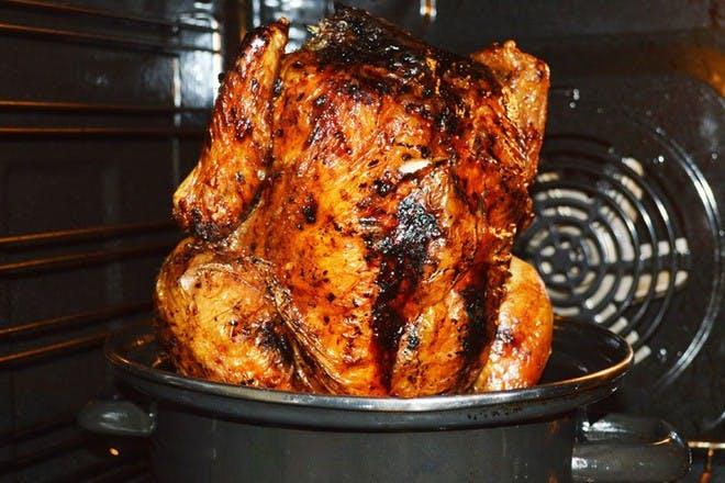 chicken in pot in oven