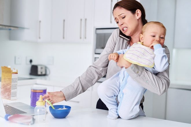 Mum on phone while feeding baby