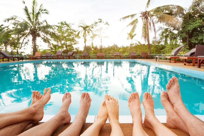 Feet by swimming pool