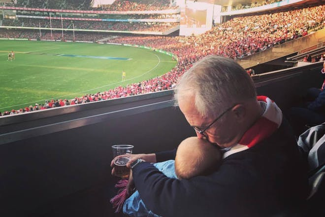 Malcolm Turnbull with baby and beer