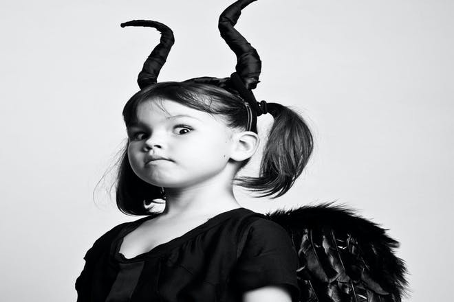 Little girl dressed as Maleficent